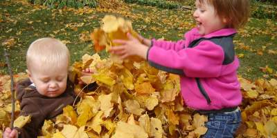 Mama O's kiddos playing in the leaves