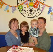 "Mama O and Family with ""Engine"" cake"