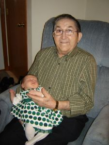 My daughter meeting Great-Grandpa at her first Christmas