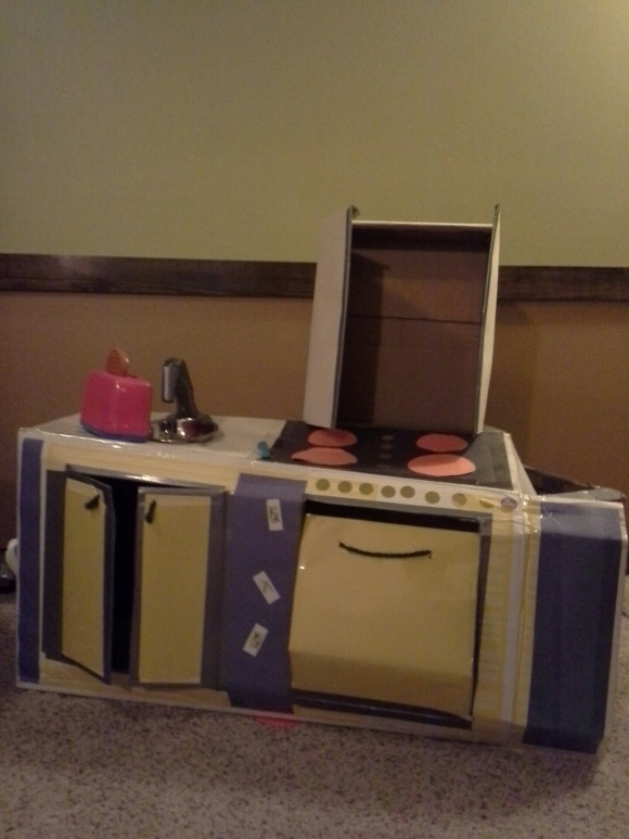Front view cardboard kitchen - 1 year later