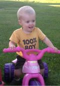 2013: SHORT haircut on his sister's big wheel
