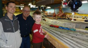 A recent picture of Daddy O., Grandpa, and little brother checking out the train layout.